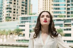 Portrait Of Beautiful Young Brunette Girl with Red lipstick Wear Royalty Free Stock Photo