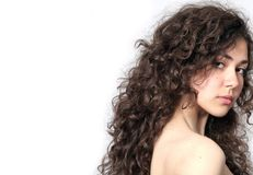 Portrait of a beautiful young brunette woman. With curly hair Royalty Free Stock Photo