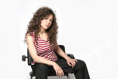 Portrait of a beautiful young brunette woman. With curly hair Stock Photography
