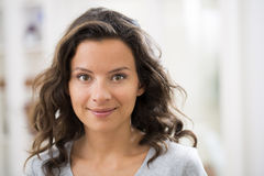 Portrait of beautiful young brunette woman with attractive smile Royalty Free Stock Photography