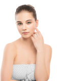 Portrait of beautiful young brunette woman with clean face. Isolated on a white. Stock Photo