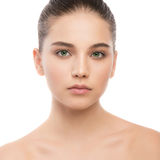 Portrait of beautiful young brunette woman with clean face. Isolated on a white. stock photography
