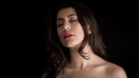 Portrait of a Beautiful Young Brunette Woman With Closed Eyes Stock Photos