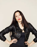 Portrait of beautiful young brunette woman in leather jacket Stock Photo