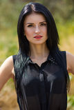 Portrait of a beautiful young brunette woman. With make-up in nature Stock Photos