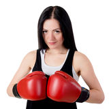 Portrait of a beautiful young brunette woman with red boxing glo Royalty Free Stock Photo