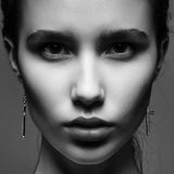 Portrait of a beautiful young brunette woman in the studio stock image
