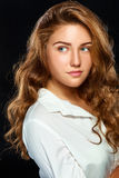 Portrait beautiful young brunette woman with wavy hair in white Royalty Free Stock Photography