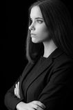 Portrait of beautiful young business woman isolated on black Royalty Free Stock Photography