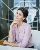 Portrait of beautiful young businesswoman at conference table Stock Photography