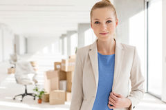 Portrait of beautiful young businesswoman in new office Stock Photos
