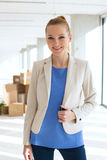 Portrait of beautiful young businesswoman smiling in new office Royalty Free Stock Photos