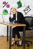 Portrait of a beautiful young businesswoman wearing a white shirt and black suit and thinking. Business concept. royalty free stock photography