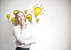 Dreamy blonde businesswoman, idea Royalty Free Stock Photography