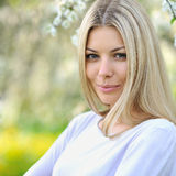 Portrait of a beautiful young caucasian blonde woman outdoor Stock Image