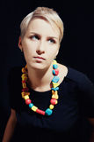 Beautiful young caucasian girl in colorful beads Stock Photography