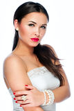 Portrait of beautiful young caucasian woman. With shiny red / pink lips and nails manicure Stock Image
