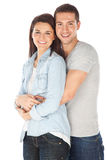 Cheerful young couple standing on white background royalty free stock photo