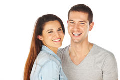 Cheerful young couple standing on white background Stock Photos