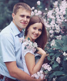 Portrait of beautiful young couple in the flowering spring Stock Images