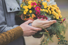 Portrait of beautiful young couple hands in soft warm colors and royalty free stock photography