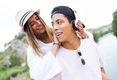 Beautiful young couple listening to music in the mountain. Portrait of beautiful young couple listening to music in the mountain Royalty Free Stock Images