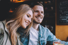 Portrait of beautiful young couple in love at a coffee shop. Stock Image