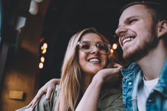 Portrait of beautiful young couple in love at a coffee shop. Portrait of beautiful young couple in love sitting in a coffee shop. Nice stylish blonde girl Stock Photos
