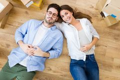 Beautiful young couple in love in their new home. Royalty Free Stock Photography
