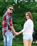 Portrait of beautiful young couple together outdoors walking Stock Images