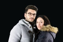 Portrait of beautiful young couple in winter clothes. Black background Stock Photo