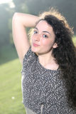 Portrait of a beautiful young curly girl against the light Stock Photo