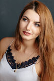 Portrait of beautiful young curly redhaired ginger girl. Portrait of beautiful young curly redhaired ginger girl with perfect fashion make up Stock Image