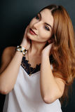 Portrait of beautiful young curly redhaired ginger girl. Portrait of beautiful young curly redhaired ginger girl with perfect fashion make up Stock Photo