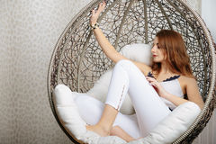 Portrait of beautiful young curly redhaired ginger girl with perfect fashion make. Royalty Free Stock Photo