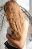 Portrait of beautiful young curly redhaired ginger girl with perfect fashion make. Portrait of beautiful young curly redhaired ginger girl with perfect fashion Stock Image