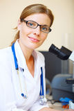 Portrait of beautiful young doctor Stock Photos