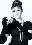 Portrait of a beautiful young elegant woman with a vintage camera stock photos
