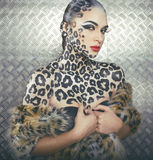 Portrait of beautiful young european model in cat make-up and bodyart Royalty Free Stock Photo
