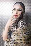Portrait of beautiful young european model in cat make-up and bodyart Stock Photography