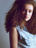 Portrait of a beautiful young fashion model in denim shirt Stock Photography