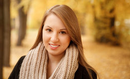 Portrait of beautiful young female. In autumn forest smiling looking at camera Stock Photos