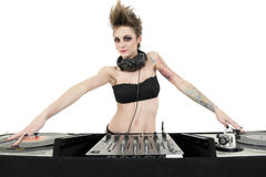 Portrait of beautiful young female DJ wearing strapless lingerie over white background Stock Photos