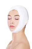 Portrait of beautiful young female face with bandage Stock Images