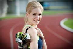 Portrait of a beautiful young female sprinter Stock Photos