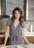 Portrait of beautiful young female with tile samples on kitchen counter Royalty Free Stock Images