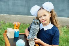 Portrait of beautiful young first-grader Farewell Bell. day of knowledge. beginning of the school year royalty free stock image