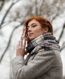 Portrait of beautiful young gir lwith red hair in autumn Royalty Free Stock Photography
