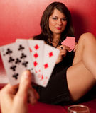 Portrait of beautiful young girl. Play poker Royalty Free Stock Image