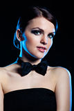 Portrait of beautiful young girl with black bow tie Royalty Free Stock Images